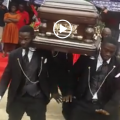Pallbearers dancing with the body at a funeral in Ghana (Video)