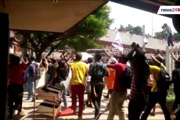 University of Johannesburg students break locked gate and confront campus security